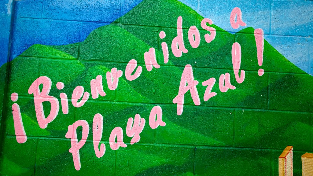 Azul Beach showing signage and outdoor art