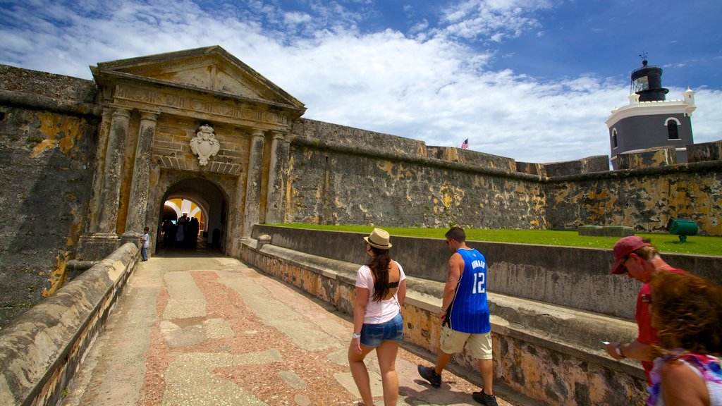 El Morro showing heritage elements as well as a small group of people