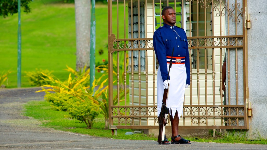 Suva which includes an administrative buidling and military items as well as an individual male