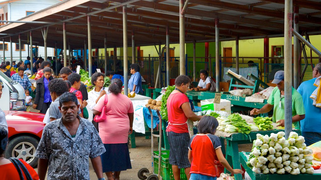 Suva which includes markets and street scenes as well as a large group of people