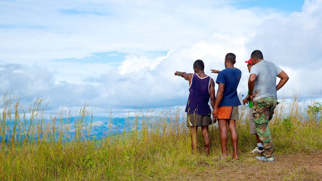 Fiji which includes views and hiking or walking as well as a small group of people