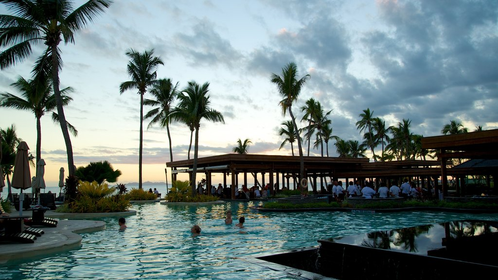 Nadi which includes swimming, tropical scenes and a pool