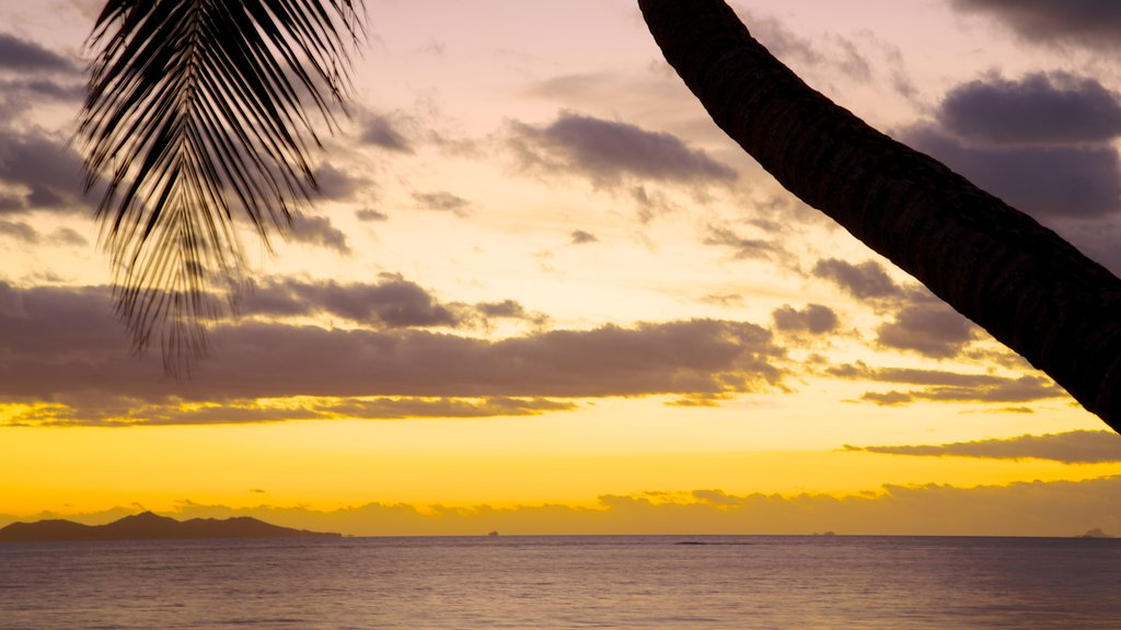Nadi which includes general coastal views, a sunset and tropical scenes