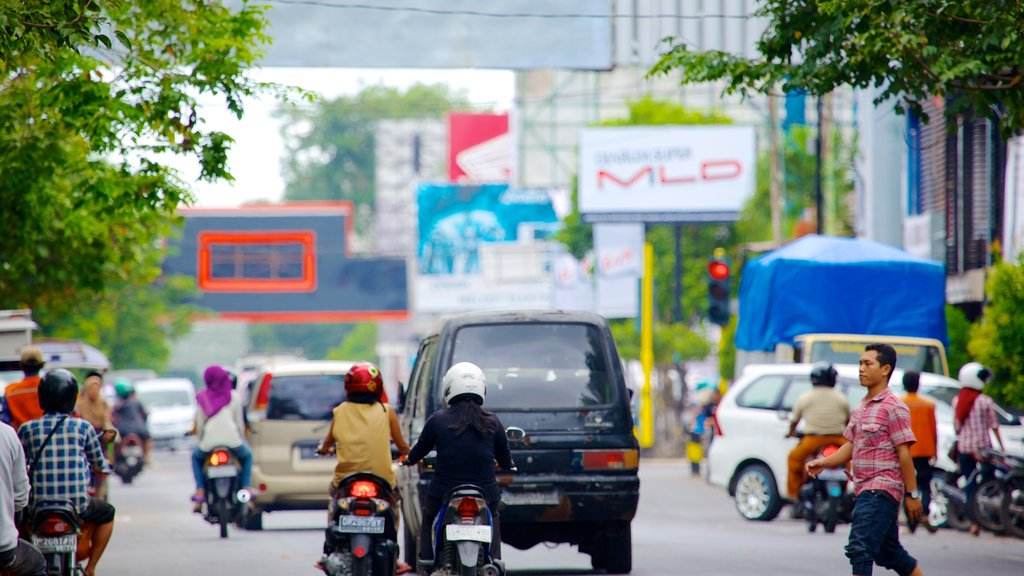 Mataram showing a city, street scenes and motorcycle riding