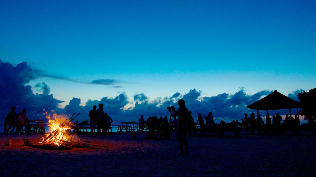 Gili Islands featuring night scenes as well as a large group of people