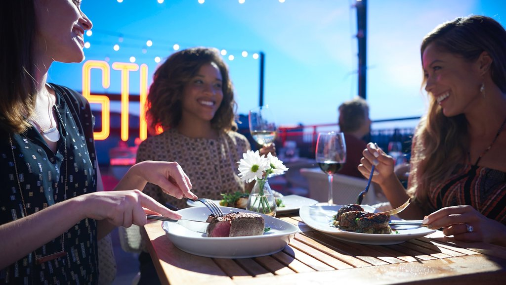 Disney Springs® featuring night scenes, dining out and food