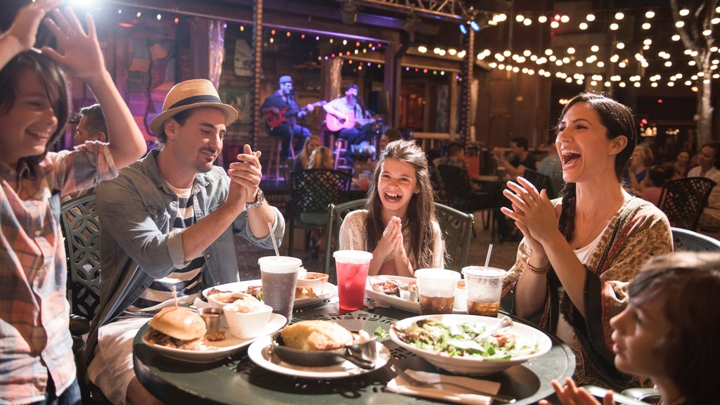 Disney Springs® which includes dining out, food and night scenes