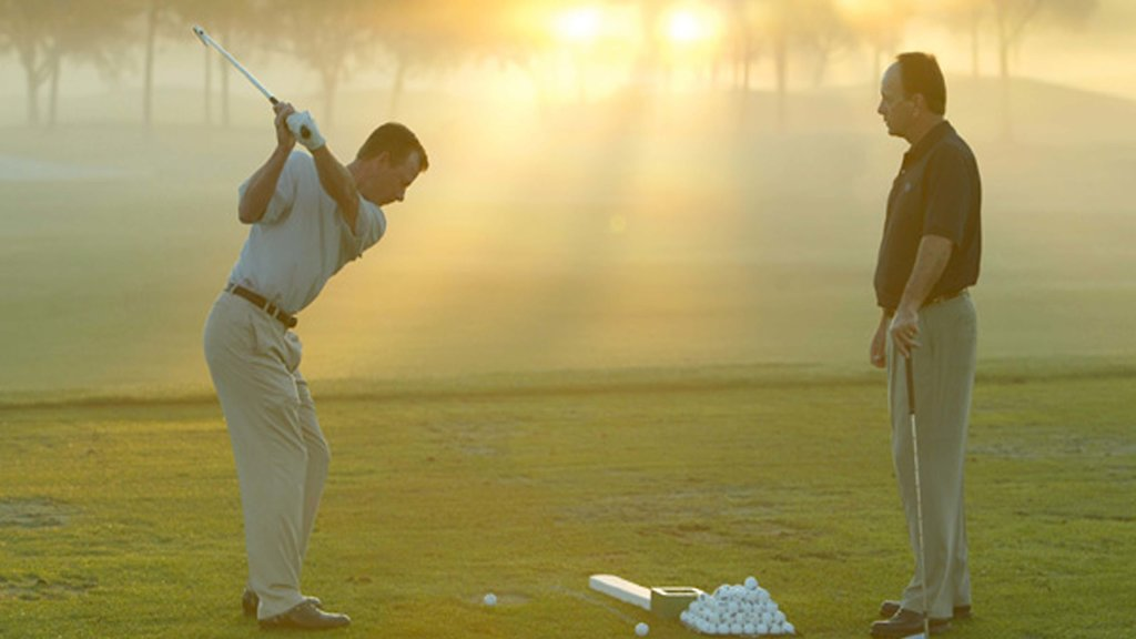 Grand Cypress Golf Club which includes golf and a sunset as well as a couple