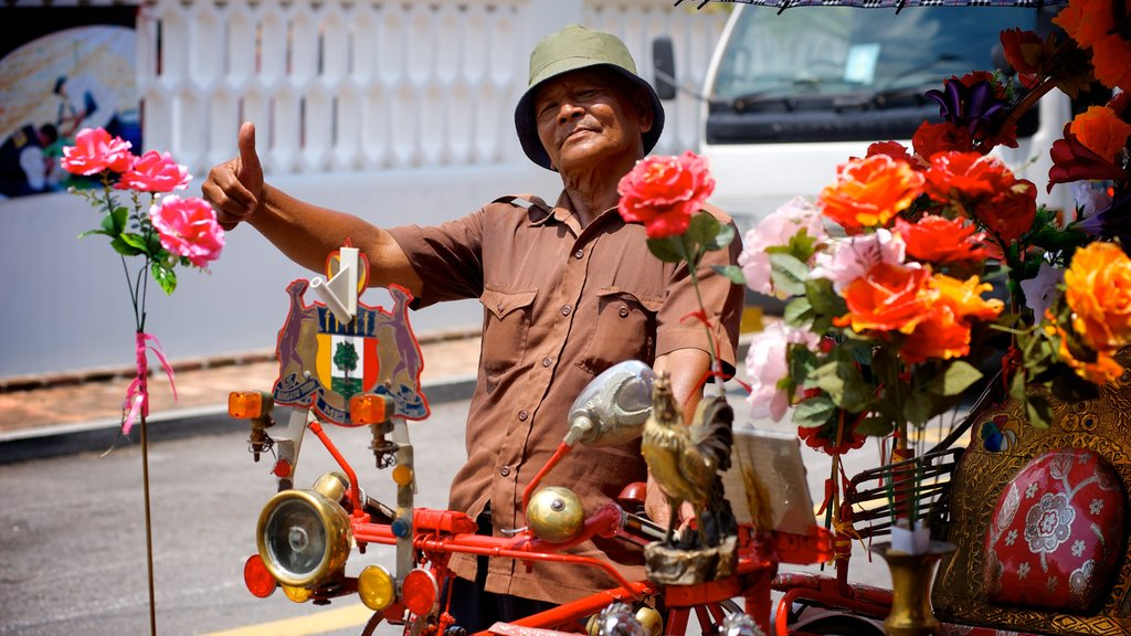 Melaka Historical City which includes street scenes and flowers as well as an individual male