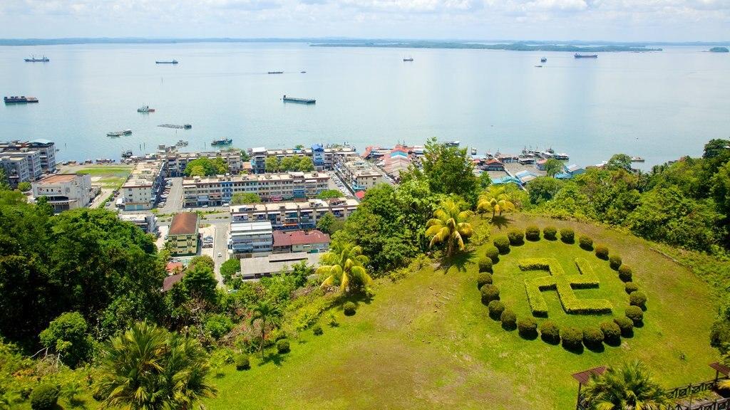 Sandakan showing a city, a park and general coastal views