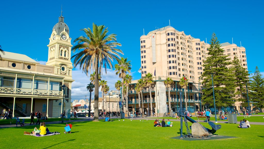 Glenelg Beach featuring tropical scenes, a garden and a city