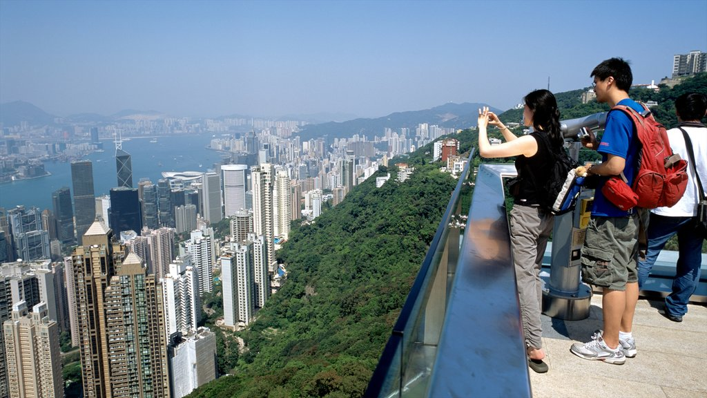Victoria Peak Tower which includes views and a city as well as a couple