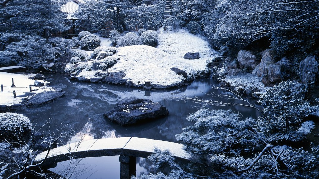 Shoren-in Temple featuring a garden, a pond and snow