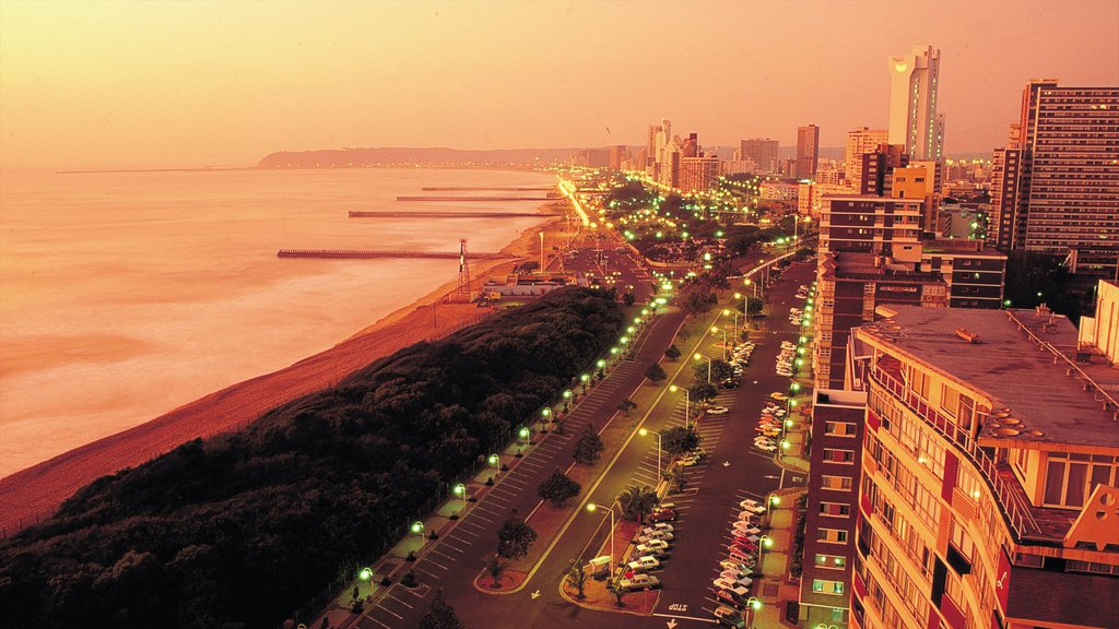 Durban which includes general coastal views, a sandy beach and a sunset