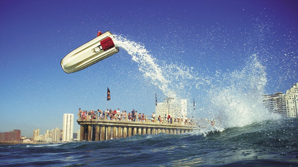 Durban showing jet skiing, surf and a marina