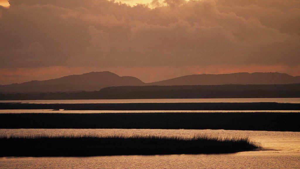 Greater St Lucia Wetland Park which includes landscape views, a sunset and mountains