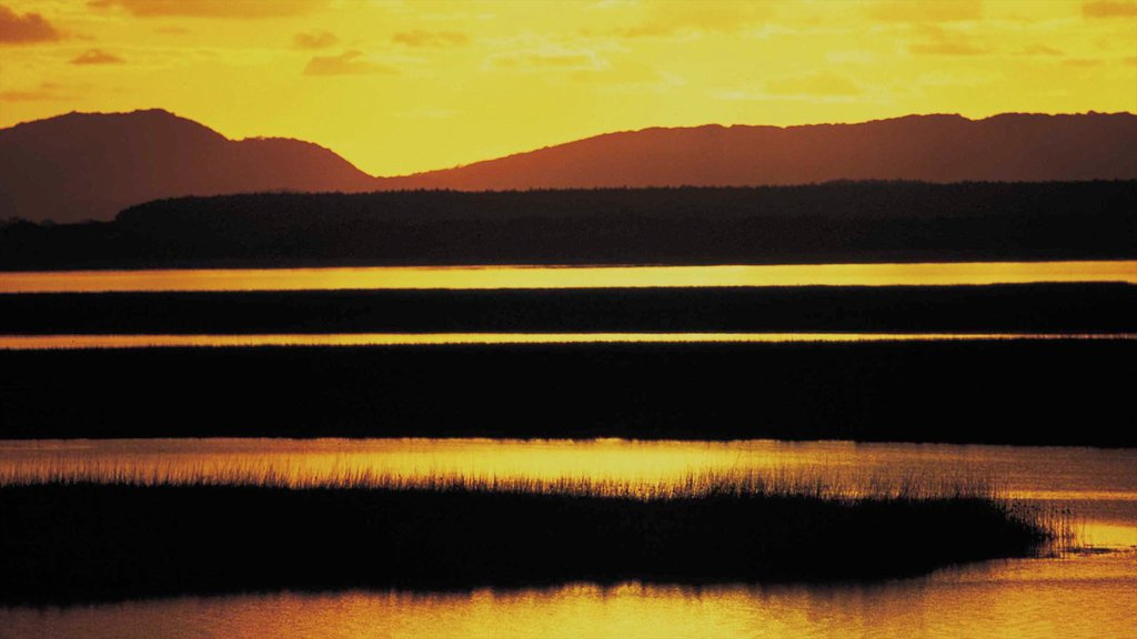 Greater St Lucia Wetland Park which includes mountains, a sunset and wetlands