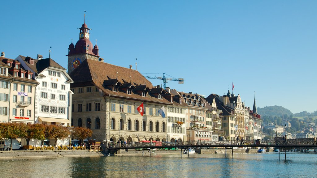 Old Town Lucerne which includes a river or creek, heritage architecture and a bridge