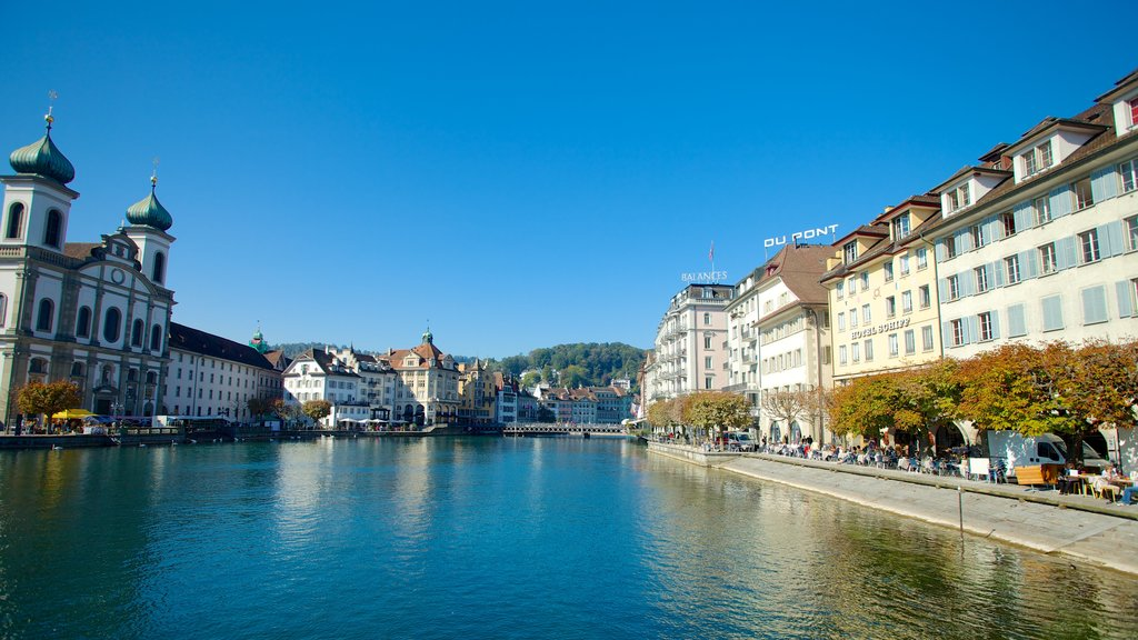 Old Town Lucerne featuring a church or cathedral, heritage architecture and a river or creek