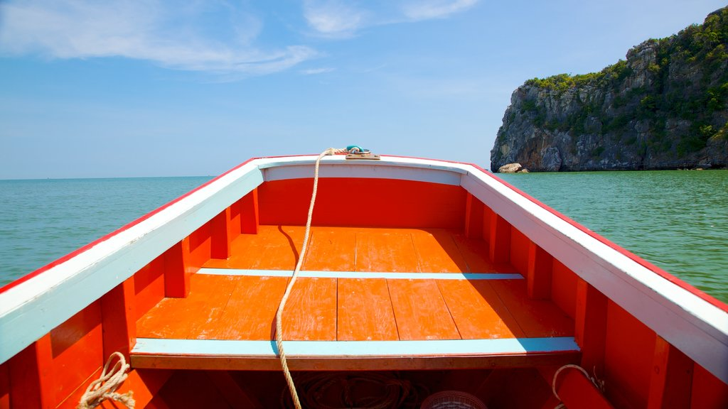 Hua Hin which includes rocky coastline and boating