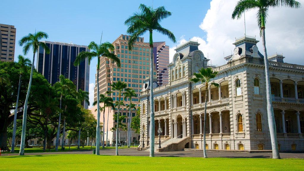 Iolani Palace which includes modern architecture, central business district and tropical scenes