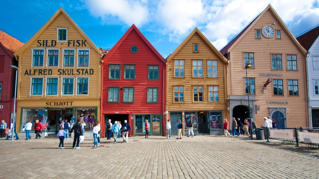 Bryggen showing a square or plaza, signage and a city