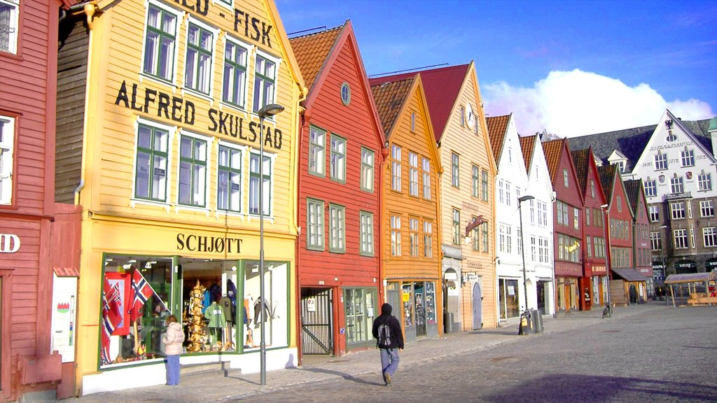 Bryggen featuring street scenes, a city and signage