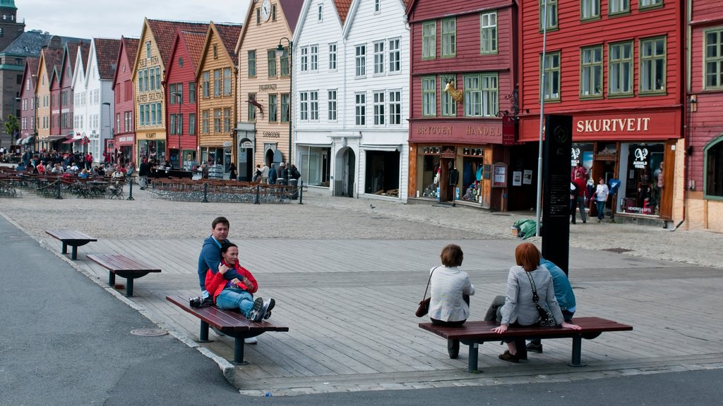 Bryggen which includes street scenes and a city as well as a small group of people