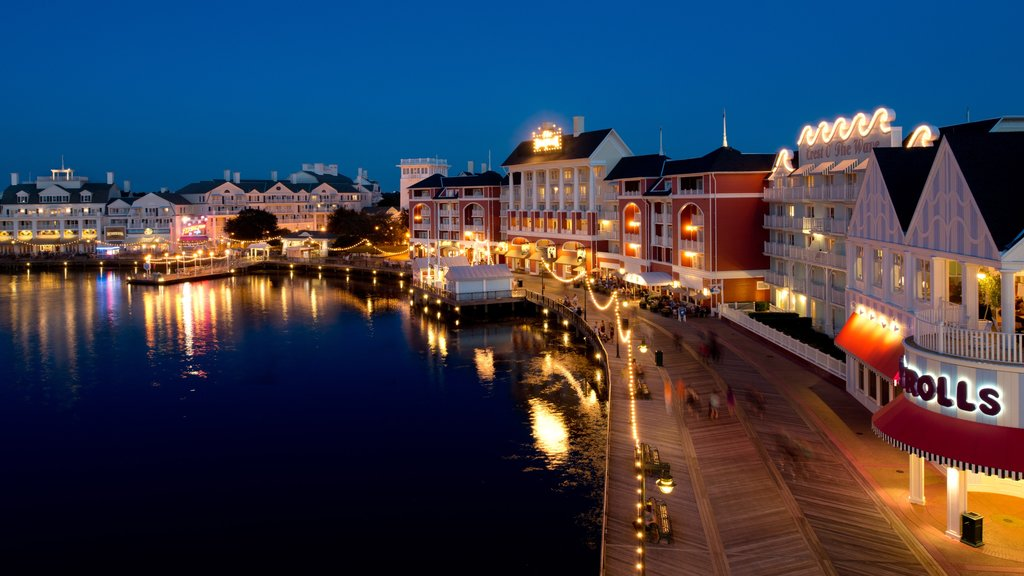 Disney\'s Boardwalk featuring night scenes and a bay or harbor