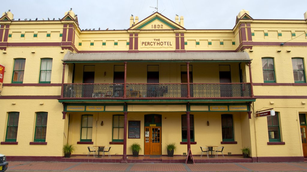 Singleton featuring signage, heritage architecture and a hotel