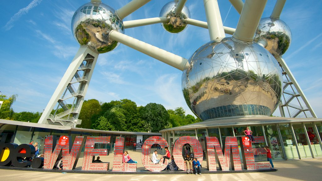 Atomium which includes a city, signage and art