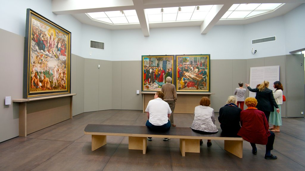 Groeningemuseum featuring interior views and art as well as a small group of people