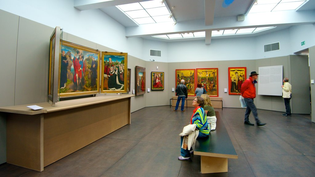 Groeningemuseum showing interior views and art as well as a small group of people
