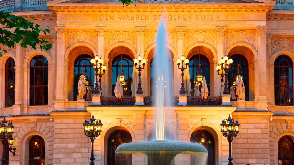 Alte Oper which includes night scenes, a fountain and heritage architecture