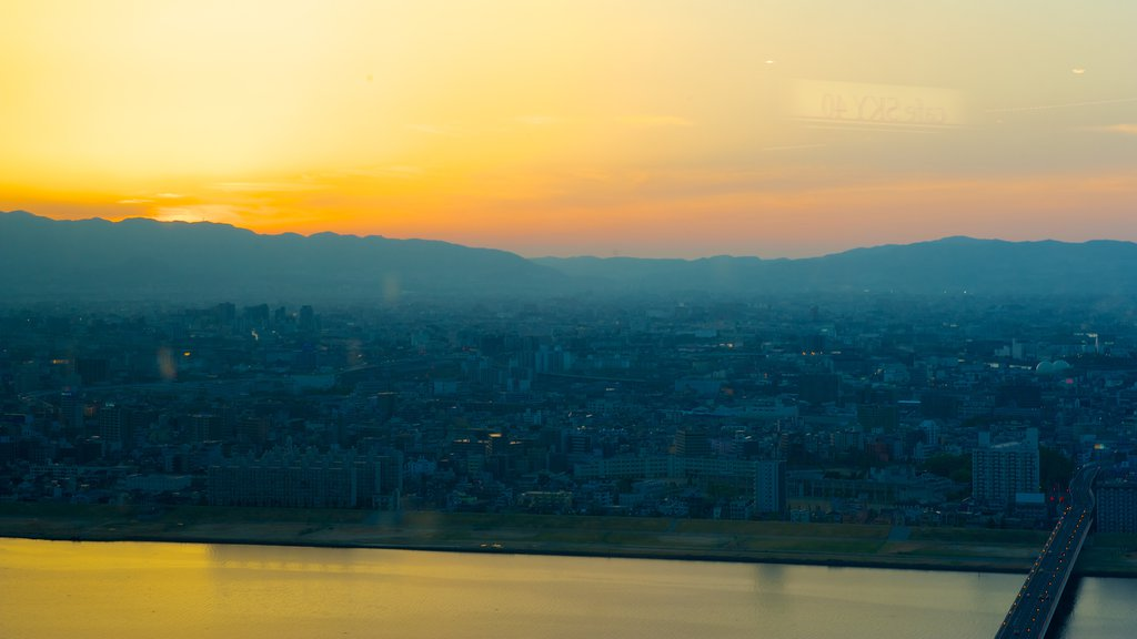 Umeda Sky Building featuring a city and a sunset