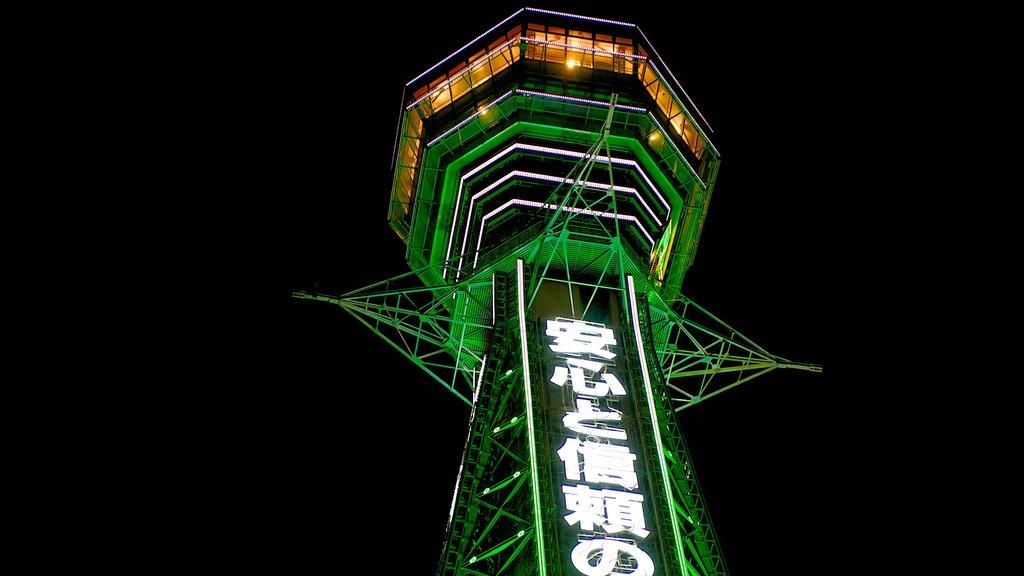 Tsutenkaku Tower featuring signage, modern architecture and night scenes
