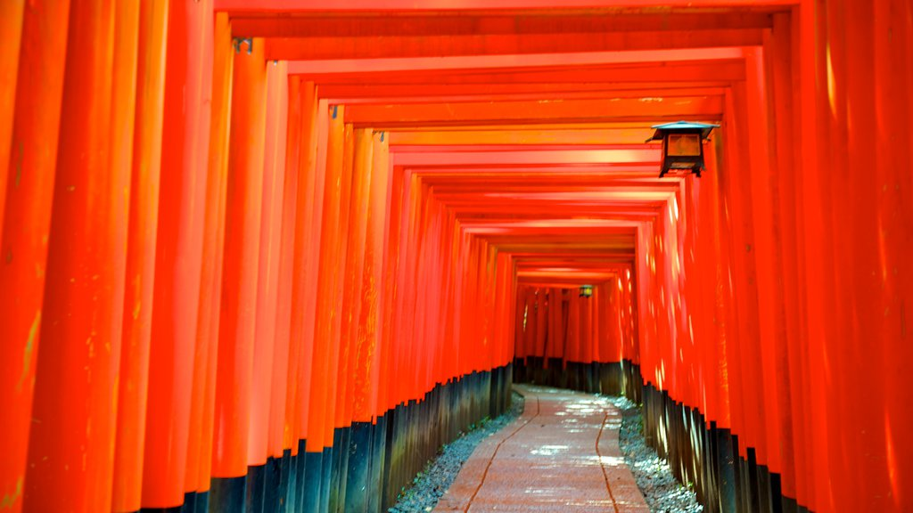Fushimi Inari Shrine showing a temple or place of worship, interior views and heritage architecture