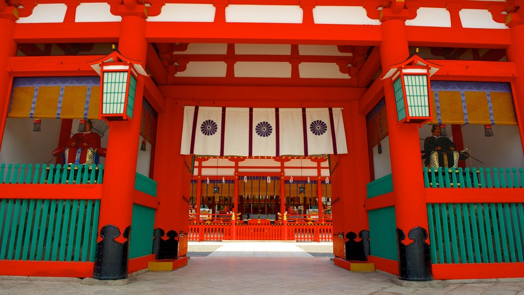 Fushimi Inari Shrine which includes a temple or place of worship, heritage architecture and religious elements