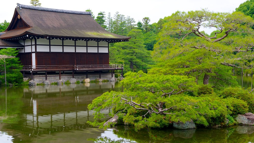 Heian Shrine featuring a pond, a garden and a temple or place of worship