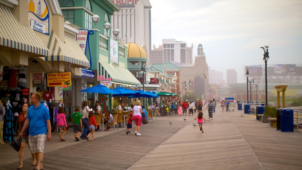 Atlantic City Boardwalk which includes a city and street scenes as well as a large group of people