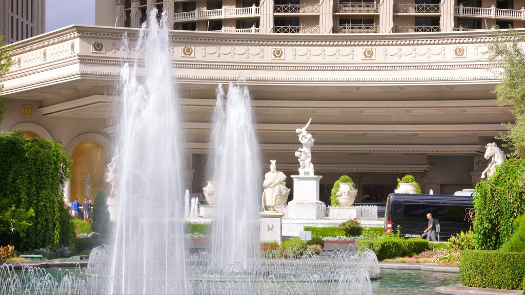 Las Vegas showing a fountain and a statue or sculpture