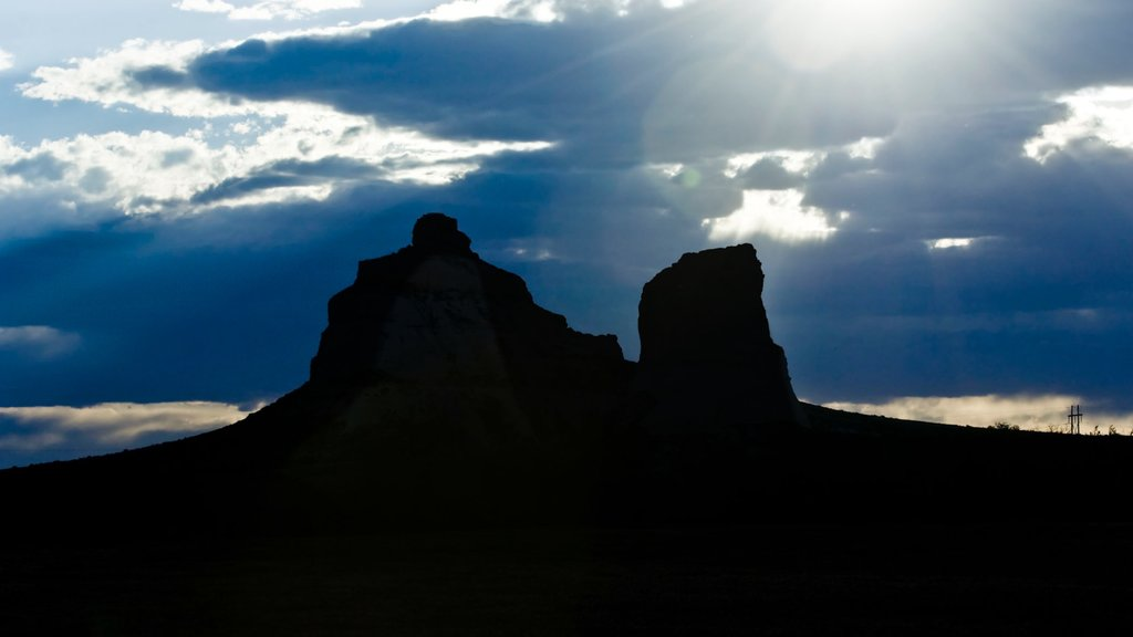 Courthouse and Jail Rocks showing a sunset, skyline and mountains