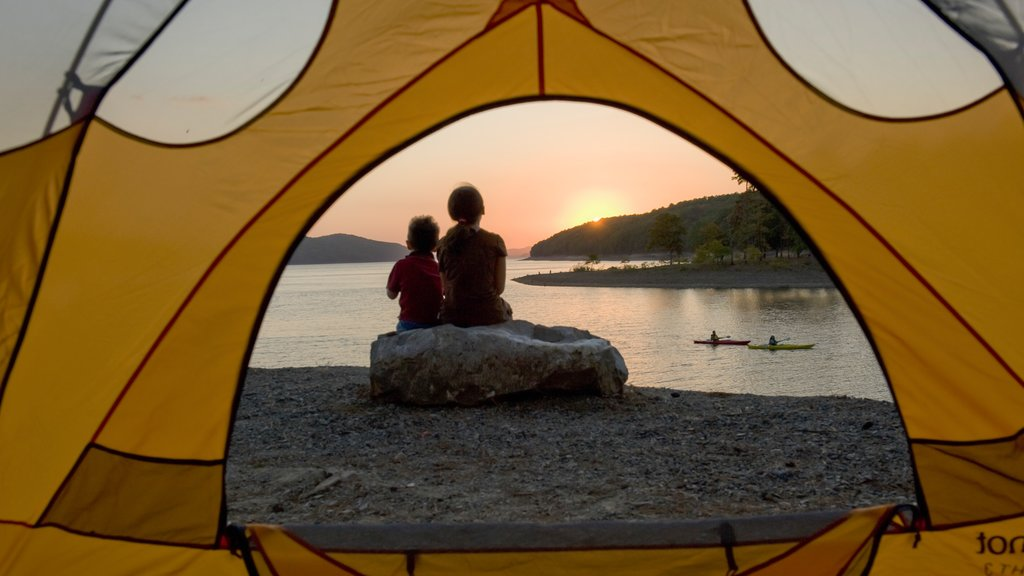 Lake Ouachita State Park featuring a sunset, camping and kayaking or canoeing