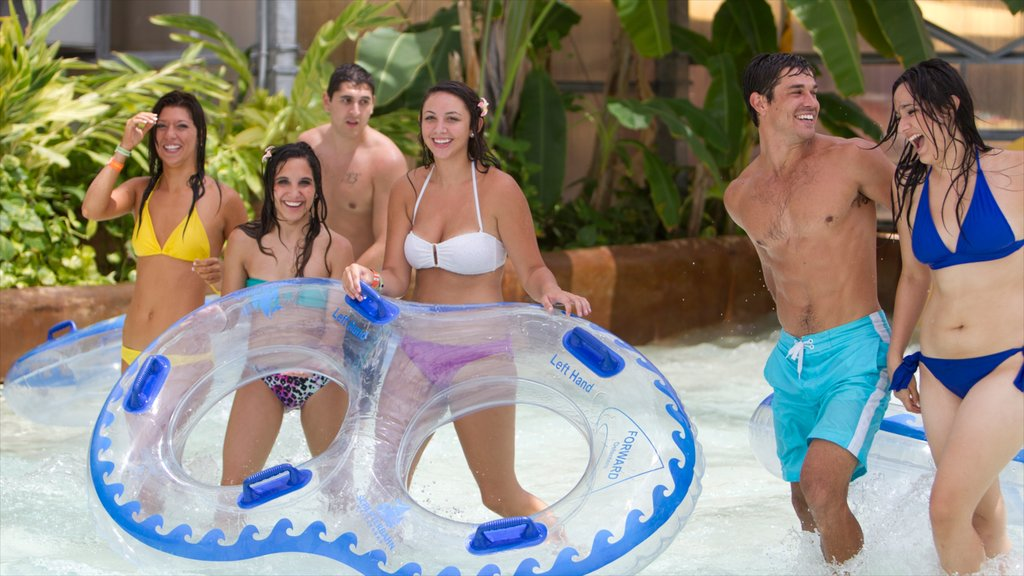 Schlitterbahn Waterpark Corpus Christi showing rafting and a waterpark as well as a small group of people