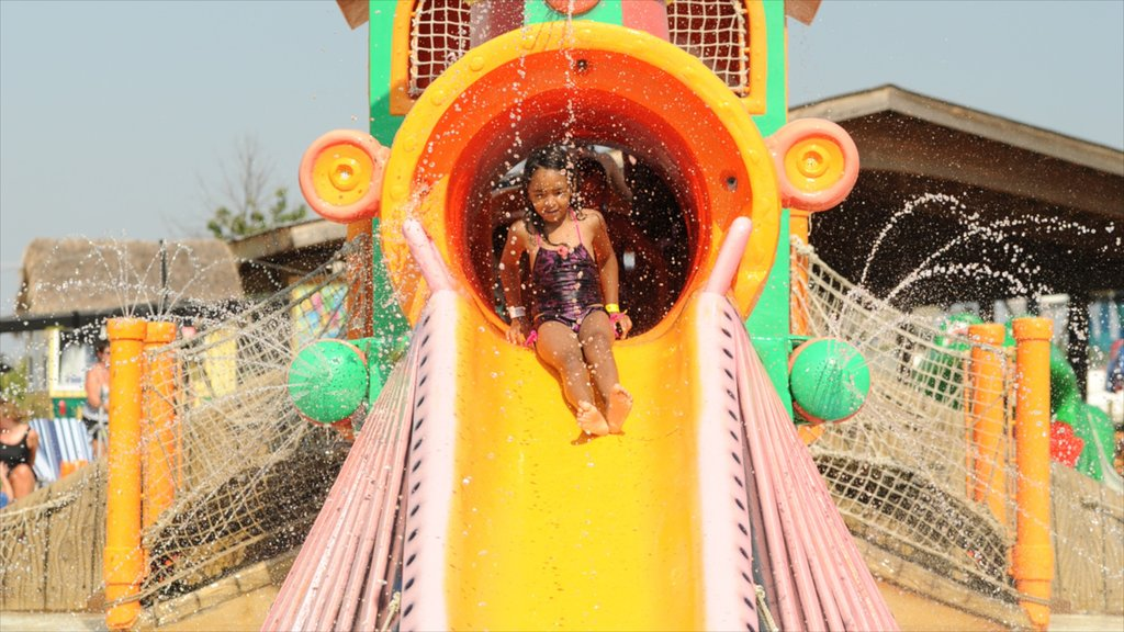 Kansas City Schlitterbahn Waterpark featuring a waterpark as well as an individual child