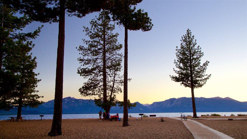 Nevada Beach which includes a sandy beach, general coastal views and a sunset