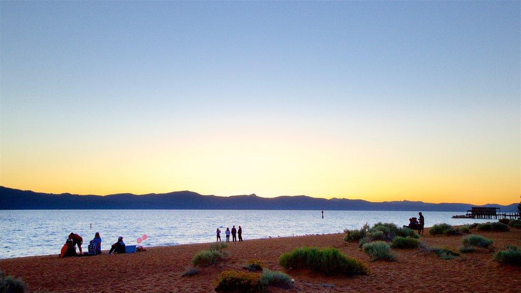 Nevada Beach which includes a sunset, general coastal views and a sandy beach