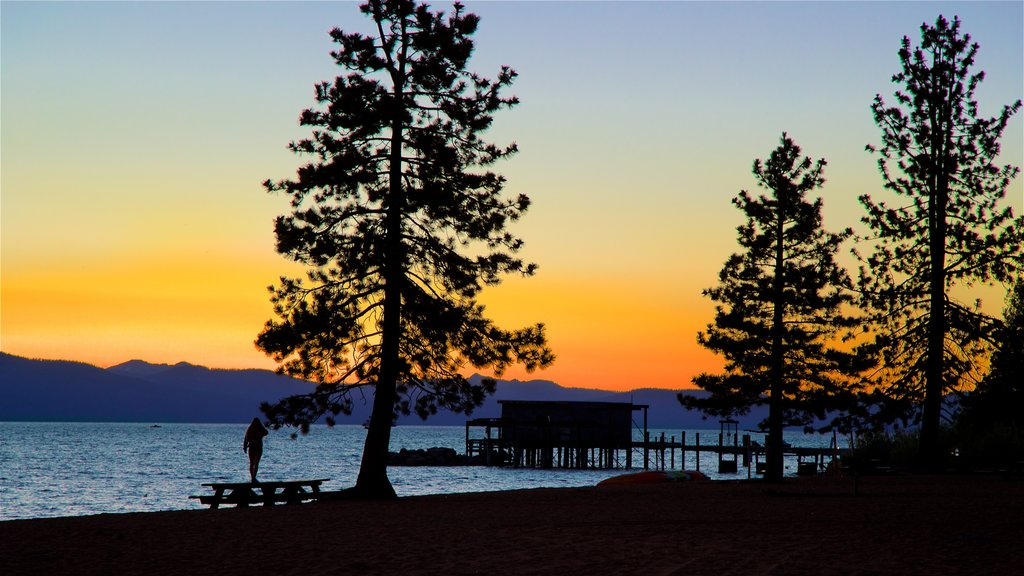 Nevada Beach showing general coastal views and a sunset