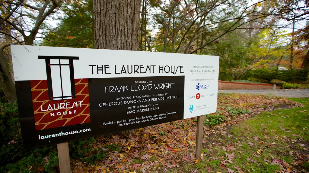 Frank Lloyd Wright\'s Laurent House which includes signage, fall colors and a garden