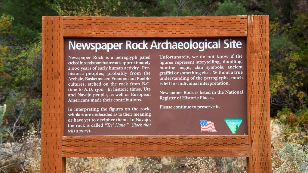Newspaper Rock State Historical Monument which includes signage